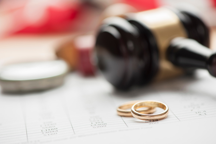 Gavel and wedding rings